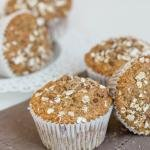 Cranberry Banana Oat Muffins on a kitchen towel