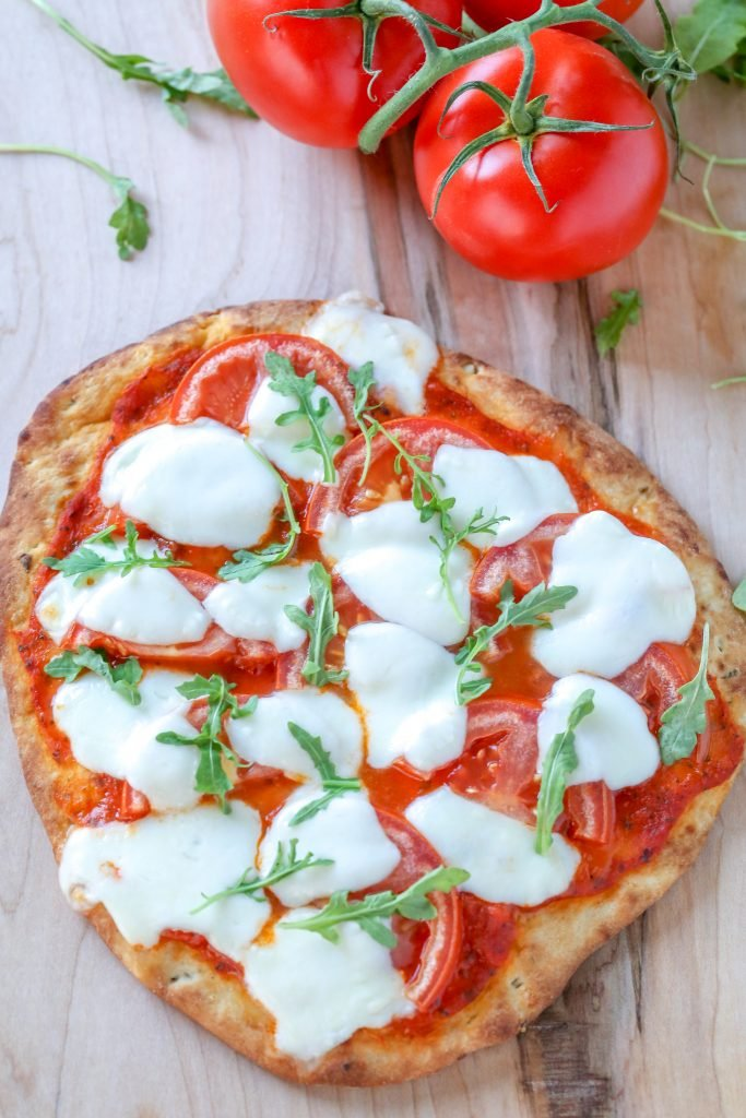 Margherita Flatbread Pizza on a cutting board