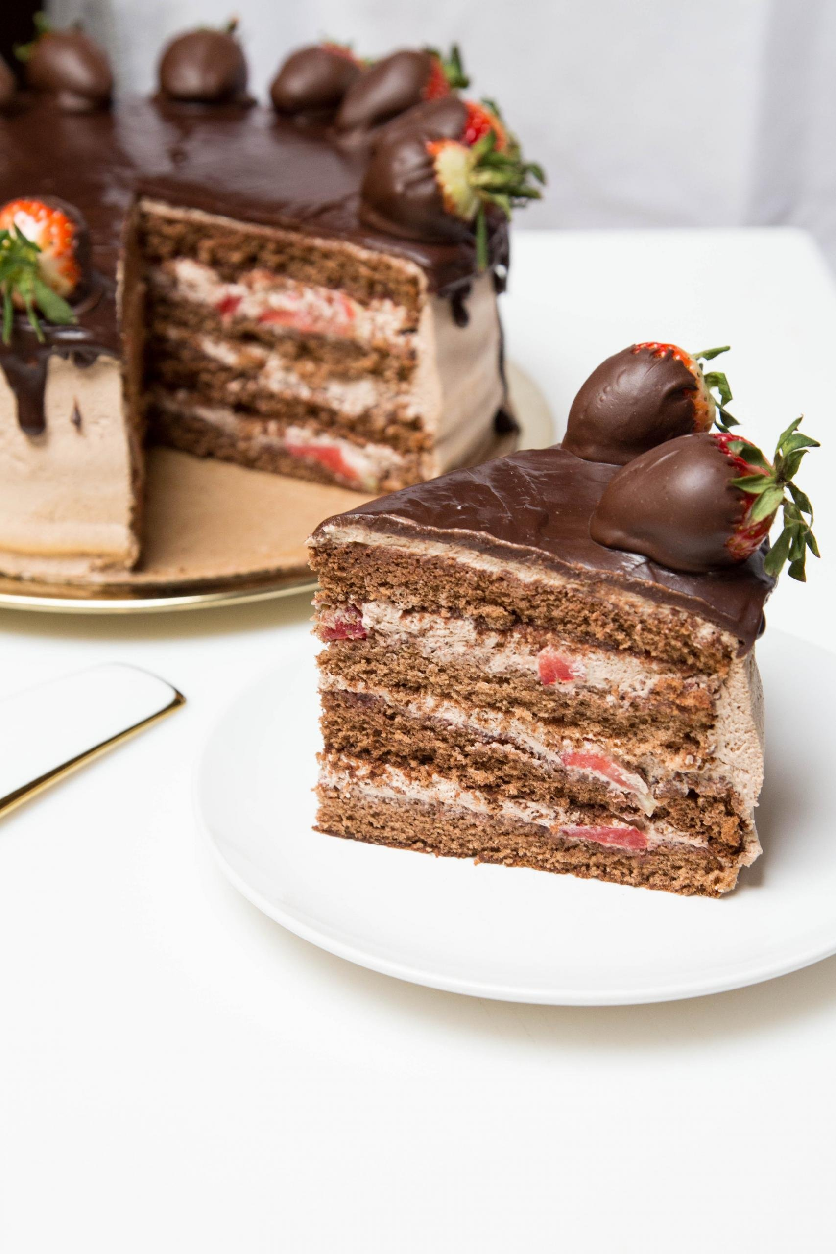 Strawberry Chocolate Cake slice on a plate