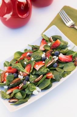 Berry Spinach Salad on a long rectangular plate