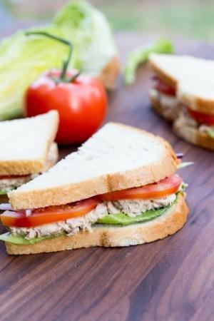 Half of a Tuna Sandwich on a cutting board