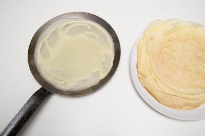 Perfect Crepes on a skillet and layered on a plate