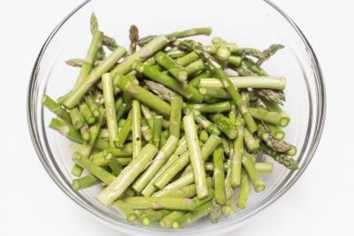 Asparagus cut up in a bowl