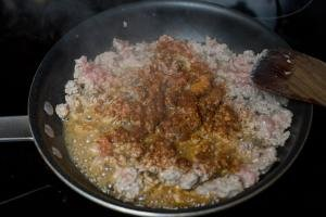 Ground turkey and taco seasoning in a skillet