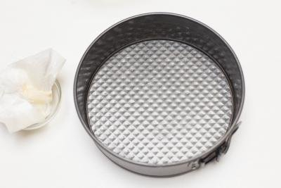 A buttered cake pan