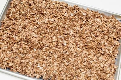 Chocolate Raspberry Granola mixture spread on baking pan
