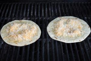 Tortillas on a grill with cheese on the tortilla