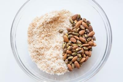 toasted coconut, almonds and pistachios in a bowl