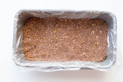 Healthy Chocolate Coconut Bar ingredients pressed down into a line baking pan