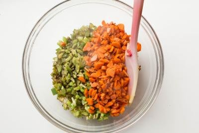 Sautéed onions, green bell peppers and carrots in bowl