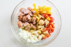 One Pan Sausage and Vegetable Bake ingredients in a bowl