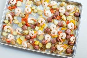 One Pan Sausage and Vegetable Bake ingredients spread on the baking pan