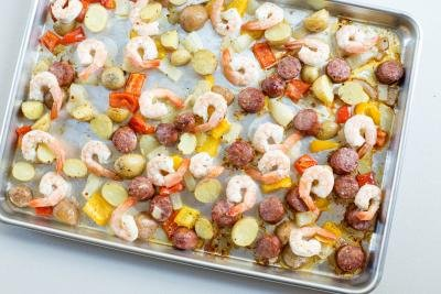 One Pan Sausage and Vegetable Bake ingredients spread on the baking pan