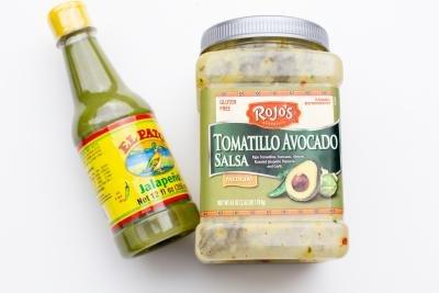 Tomatillo Avocado salsa and Jalapeños sauce on the table