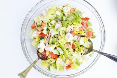 Greek Salad in a bowl with 2 spoons
