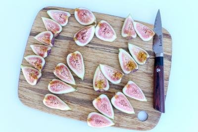 Figs cut into fourths on a cutting board