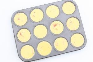 egg mixture poured into a cupcake tin