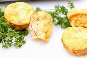 Bacon Egg Bites on a cutting board with parsley besides them