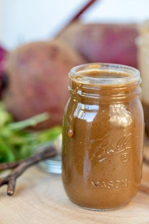 Beet Salad Dressing in a jar on a cutting board