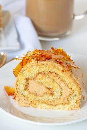 Dulce de leche cake roll on a plate