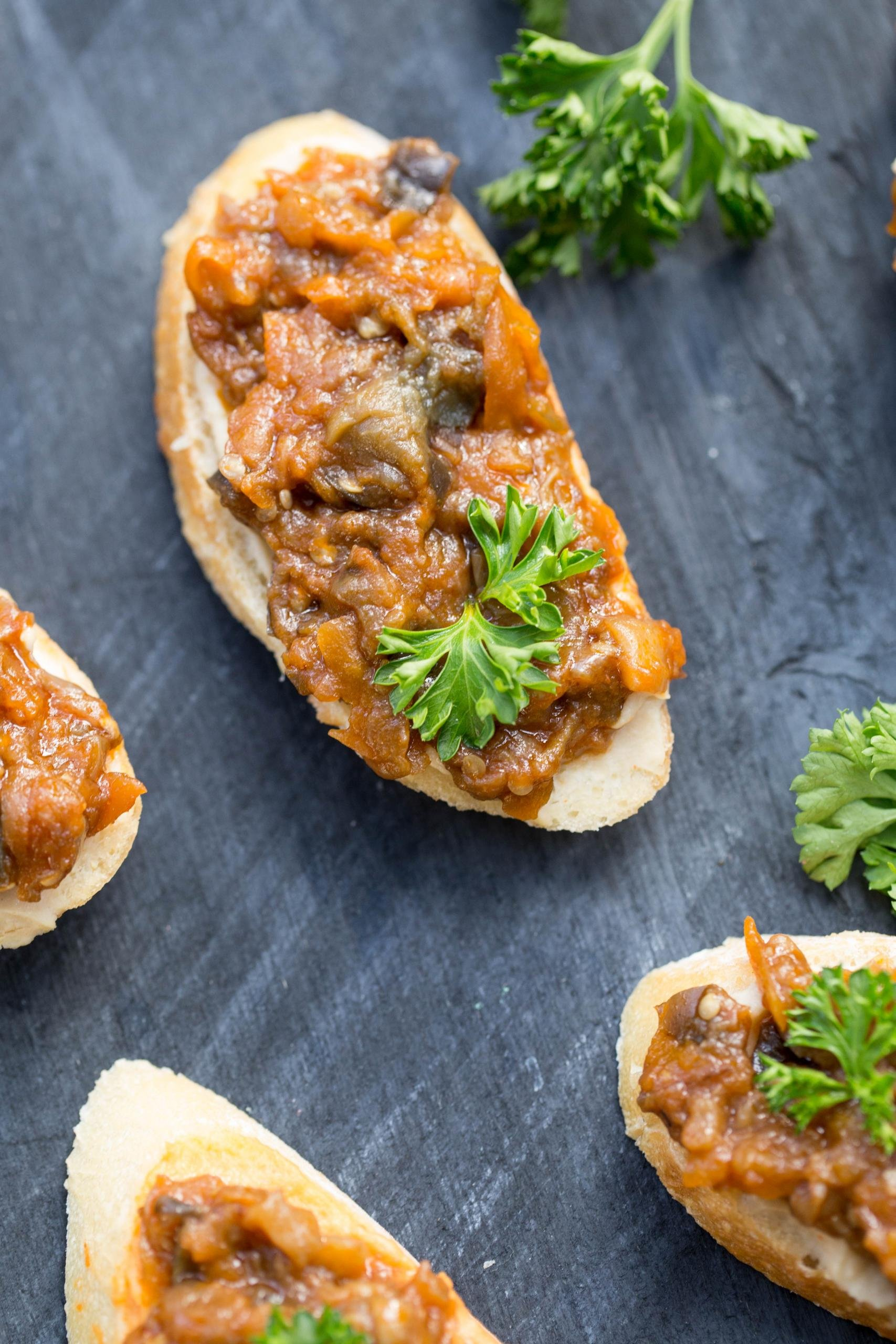 Hummus Eggplant Canapés on a cutting board