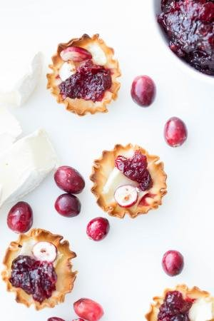 Brie and Cranberry Bites on a cutting board