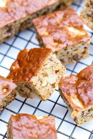 Banana Apple Bread cut into squares resting on a baking rack