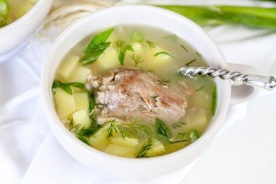 Cooked soup with cooked turkey neck.