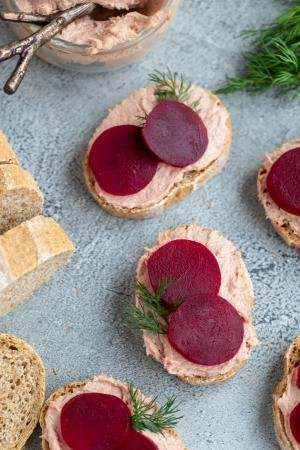 Smørrebrød with beets and pate on a tray