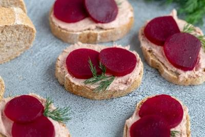 Several Pickled Beets and Pate Smørrebrød on a sheet