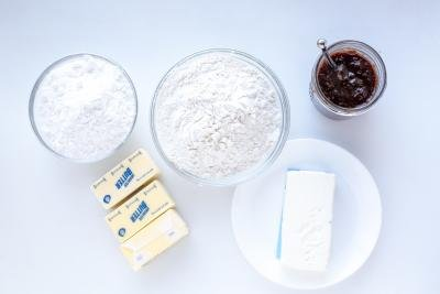 Ingredients for cookies on a white tray.