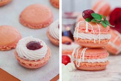 Macarons with cream and cranberry jam. Two macarons on top of each other.