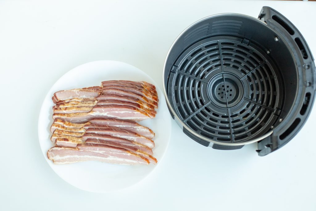 Bacon on a plate and air fryer basket