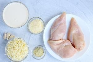Chicken, cheese, garlic and cream on a counter