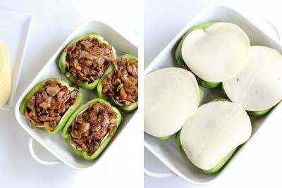 Bell peppers with filling and cheese in a baking dish