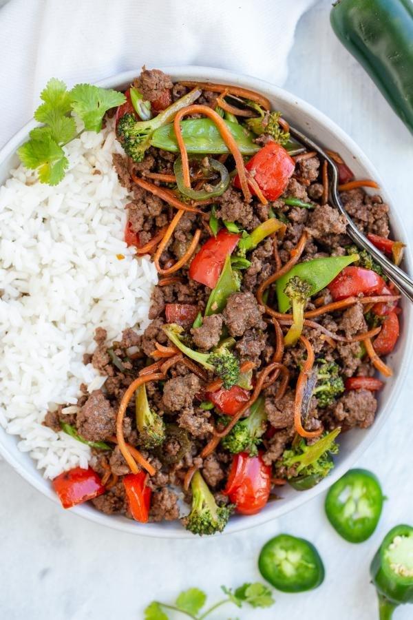 korean Beef Stir Fry on top of rice in a bowl