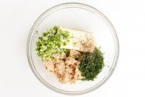 Combined ingredients for salmon dip in a glass bowl