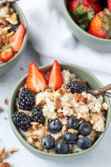 Old Fashioned Oatmeal Pudding in a bowl with fruits