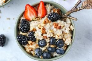 Old Fashioned Oatmeal Pudding in a bowl with berries