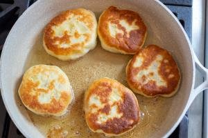 Piroshki frying in a frying pan