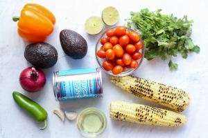 ingredients on a counter for Black bean and corn salsa