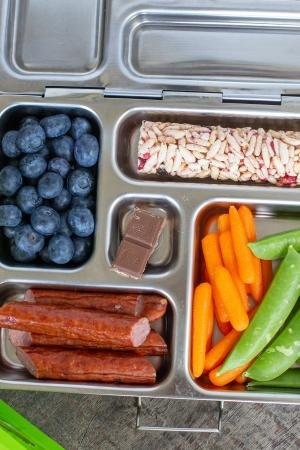 kids Cold Lunch in a tray with berried, meats, veggies