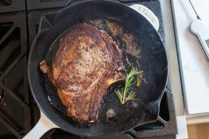Cooked Ribeye in a cast iron skillet