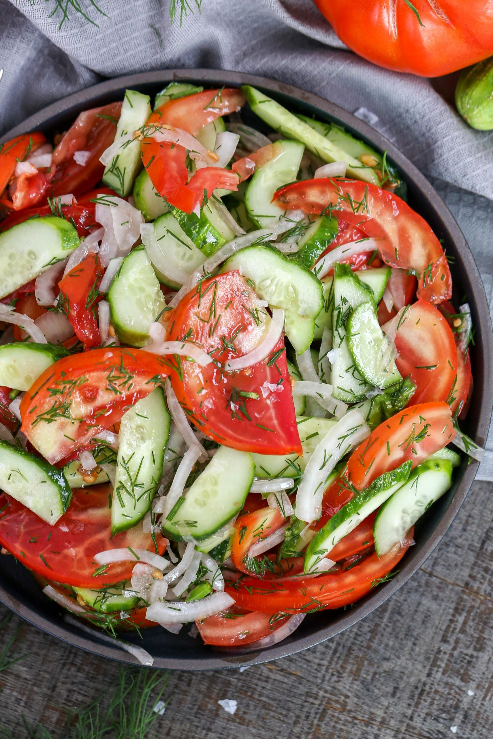 Garden Cucumber Tomato Salad in a bowl with a towel