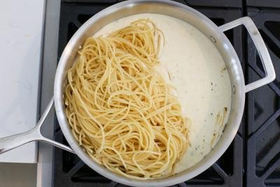 Pasta with alfredo sauce in a pan