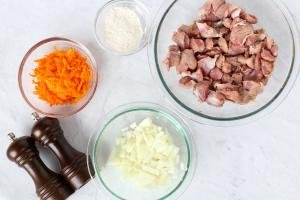 Gizzards, onion, carrots and seasoning on a counter