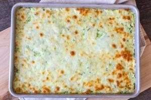 Zucchini cheesy bread on a baking sheet