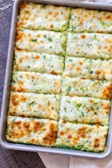 Cheesy bread sticks on a baking sheet