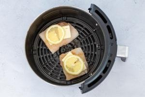 Cod in airfryer basket with cod and lemon