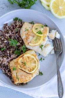 Crispy Air Fryer Cod in a plate with rice
